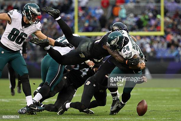 Inside linebacker CJ Mosley of the Baltimore Ravens knocks the ball loose from running back Ryan Mathews of the Philadelphia Eagles in the second...