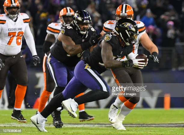 Inside linebacker CJ Mosley of the Baltimore Ravens returns an interception in the fourth quarter of a game against the Cleveland Browns on December...