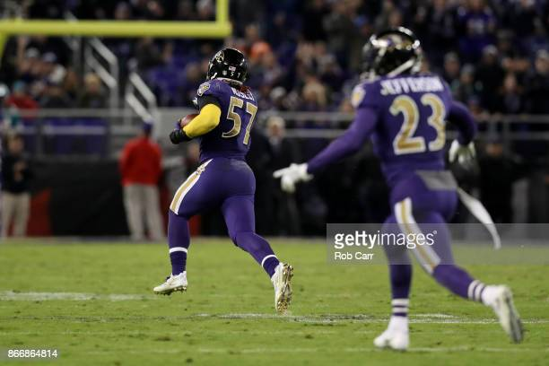 Inside Linebacker CJ Mosley of the Baltimore Ravens runs back an interception for a touchdown in the fourth quarter against the Miami Dolphins at MT...