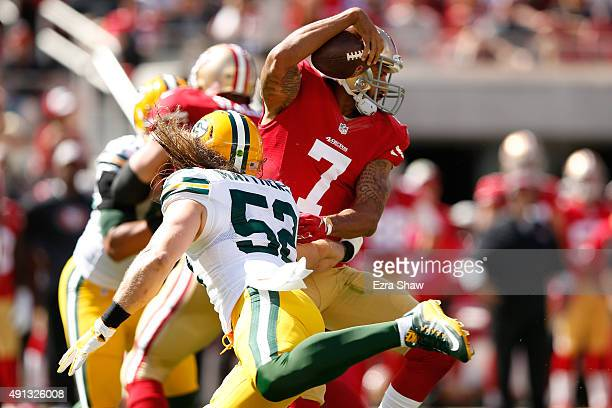 Inside linebacker Clay Matthews of the Green Bay Packers hits quarterback Colin Kaepernick of the San Francisco 49ers during their NFL game at Levi's...