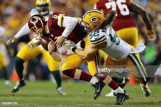 Inside linebacker Clay Matthews of the Green Bay Packers sacks quarterback Kirk Cousins of the Washington Redskins in the first quarter during the...