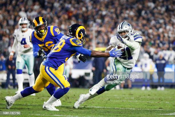 Inside linebacker Cory Littleton of the Los Angeles Rams tackles running back Ezekiel Elliott of the Dallas Cowboys in the fourth quarter of the NFC...