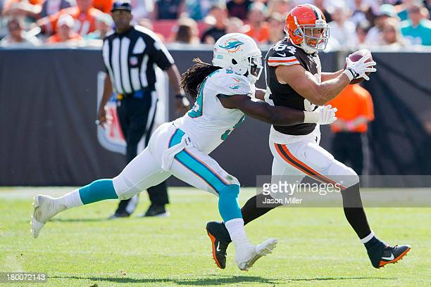Inside linebacker Dannell Ellerbe of the Miami Dolphins tackles tight end Jordan Cameron of the Cleveland Browns during the second half at First...