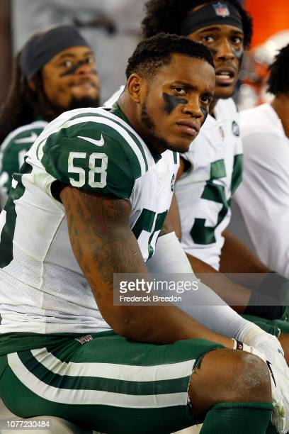 Inside Linebacker Darron Lee of the New York Jets watches from the sideline during a game against the Tennessee Titans at Nissan Stadium on December...