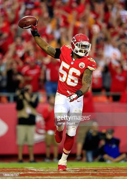 Inside linebacker Derrick Johnson of the Kansas City Chiefs celebrates after causing and recovering a fumble late in the 2nd half of the game against...