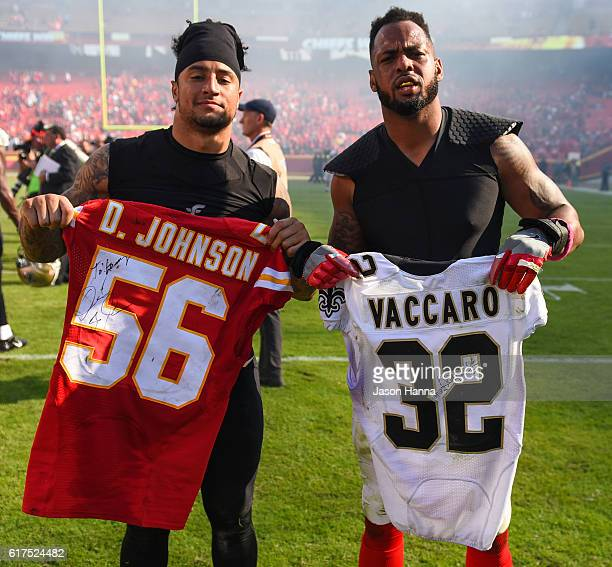 Inside linebacker Derrick Johnson of the Kansas City Chiefs and strong safety Kenny Vaccaro of the New Orleans Saints exchange jerseys following the...
