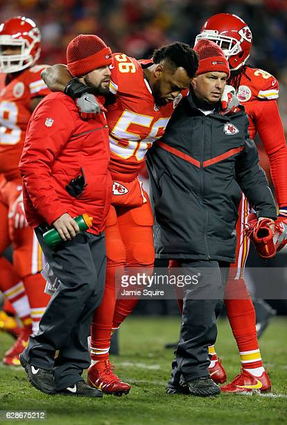 Inside linebacker Derrick Johnson of the Kansas City Chiefs is helped off the field after an injury during the game against the Oakland Raiders at...