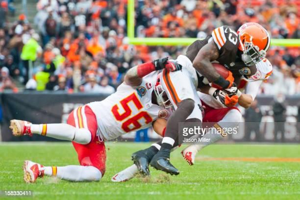 Inside linebacker Derrick Johnson of the Kansas City Chiefs tackles wide receiver Josh Gordon of the Cleveland Browns against the Kansas City Chiefs...