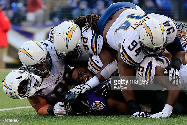 Inside linebacker Donald Butler of the San Diego Chargers loses his helmet while making a fourth quarter tackle on running back Justin Forsett of the...