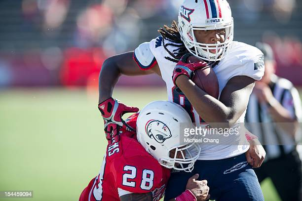 Inside linebacker Enrique Williams of the South Alabama Jaguars hits tightend Alex Deleon of the Florida Atlantic Owls on October 20 2012 at...