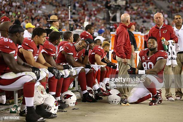 Inside linebacker Jasper Brinkley and defensive end Darnell Dockett of the Arizona Cardinals react on the bench with teamamtes during the final...