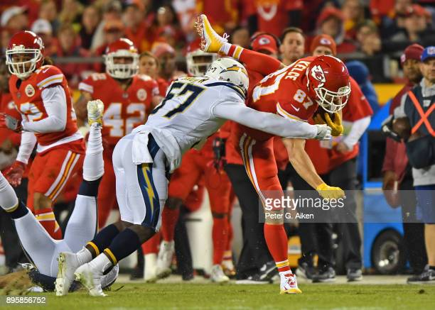 Inside linebacker Jatavis Brown of the Los Angeles Chargers tackles tight end Travis Kelce of the Kansas City Chiefs during the first half at...