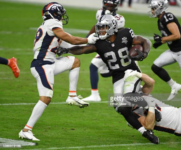 Inside linebacker Josey Jewell of the Denver Broncos tackles running back Josh Jacobs of the Las Vegas Raiders as he runs for a first down against...