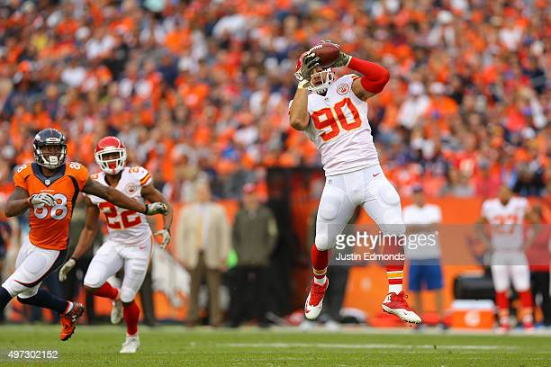 Inside linebacker Josh Mauga of the Kansas City Chiefs intercepts a pass intended for wide receiver Demaryius Thomas of the Denver Broncos as Marcus...