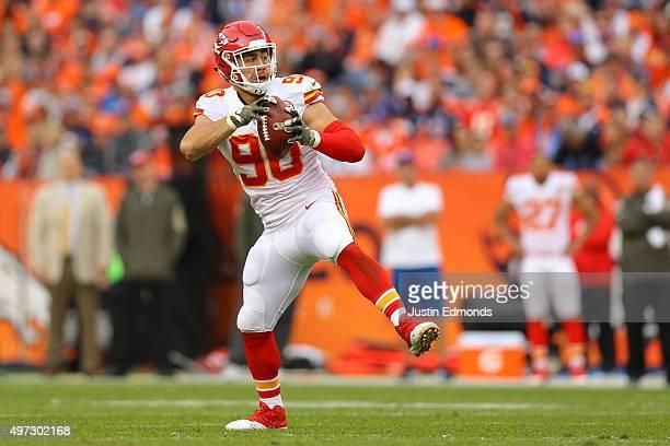 Inside linebacker Josh Mauga of the Kansas City Chiefs intercepts a pass against the Denver Broncos during the second quarter at Sports Authority...