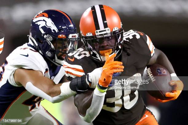 Inside linebacker Justin Strnad of the Denver Broncos tackles running back D'Ernest Johnson of the Cleveland Browns in the first half at FirstEnergy...