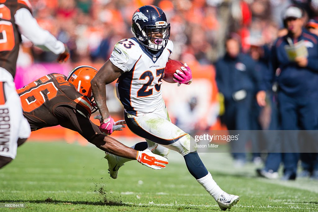 Inside linebacker Karlos Dansby #56 of the Cleveland Browns tackles running back Ronnie Hillman #23 of the Denver Broncos during the second half at FirstEnergy Stadium on October 18, 2015 in Cleveland, Ohio. The Broncos defeated the Browns 26-23 in overtime.