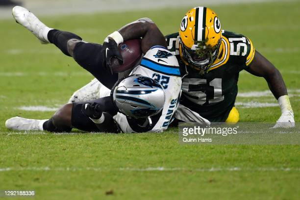 Inside linebacker Krys Barnes of the Green Bay Packers tackles running back Mike Davis of the Carolina Panthers in the third quarter of the game at...