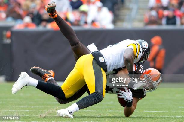 Inside linebacker Lawrence Timmons of the Pittsburgh Steelers tackles tight end Jordan Cameron of the Cleveland Browns during the first half at...