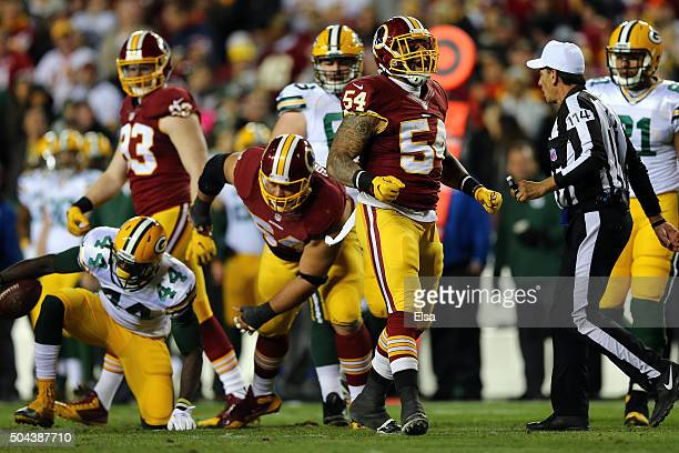 Inside linebacker Mason Foster of the Washington Redskins celebrates after tackling running back James Starks of the Green Bay Packers in the second...