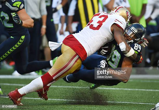 Inside linebacker NaVorro Bowman of the San Francisco 49ers tackles wide receiver Doug Baldwin of the Seattle Seahawks during the third quarter of...