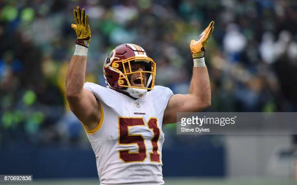 Inside linebacker Will Compton of the Washington Redskins celebrates after interceping a pass during the third quarter of the game against the...
