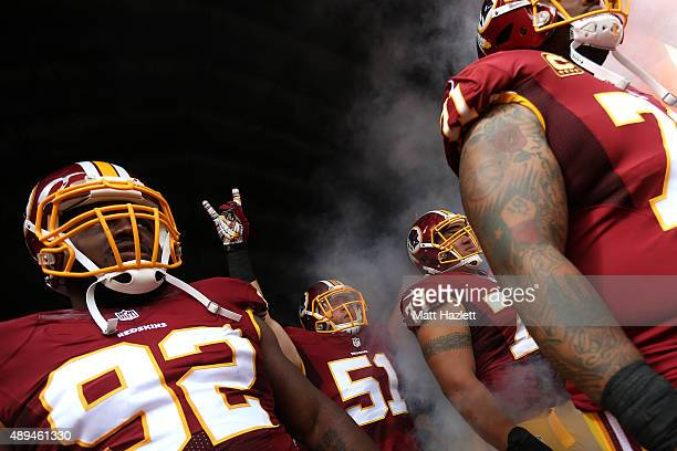 Inside linebacker Will Compton of the Washington Redskins, nose tackle Chris Baker of the Washington Redskins, guard Shawn Lauvao of the Washington...