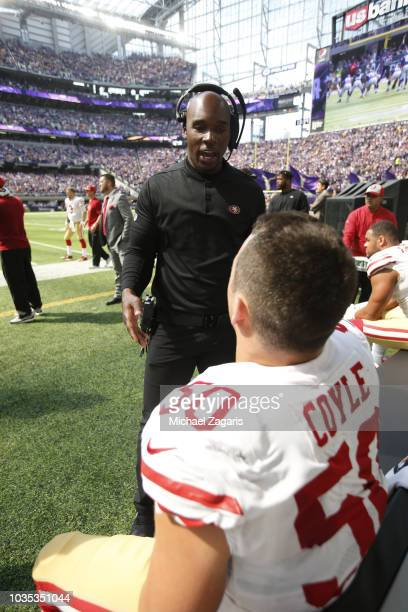 Inside Linebackers Coach DeMeco Ryans and Brock Coyle of the San Francisco 49ers talk on the sideline during the game against the Minnesota Vikings...