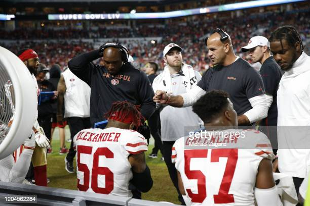 Inside Linebackers Coach DeMeco Ryans and Defensive Coordinator Robert Saleh of the San Francisco 49ers talk with the linebackers on the sideline...
