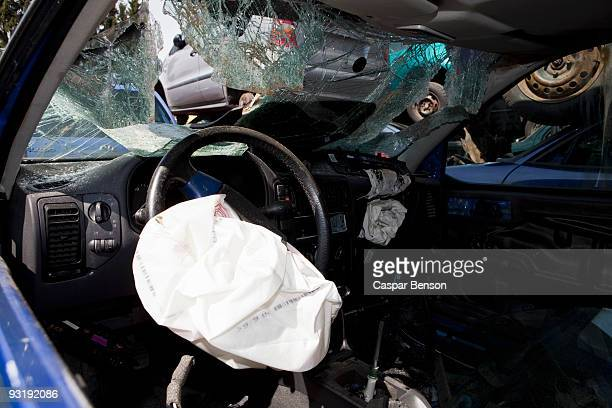 inside of a car in a junkyard - airbag foto e immagini stock