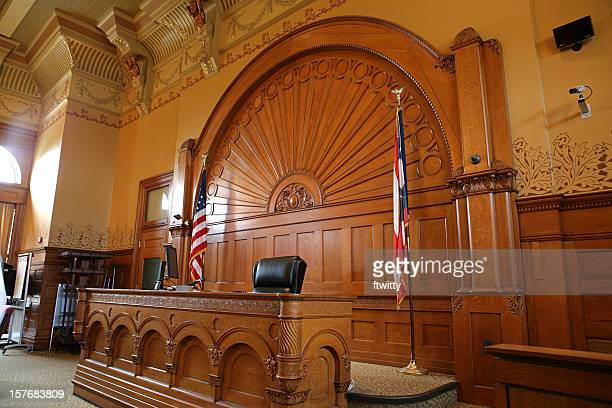 Inside of a courtroom with American flags