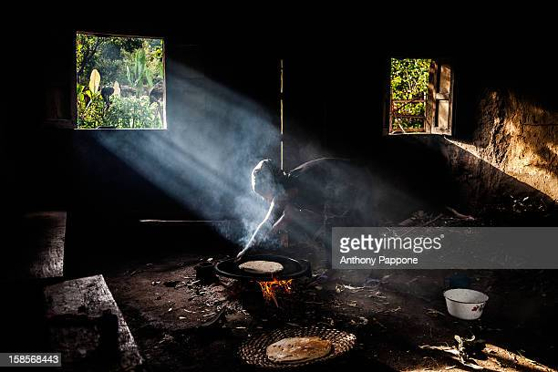 CONTENT] Inside of a hut the woman make the bread on the fire the village neae jinka omo valley ethiopia