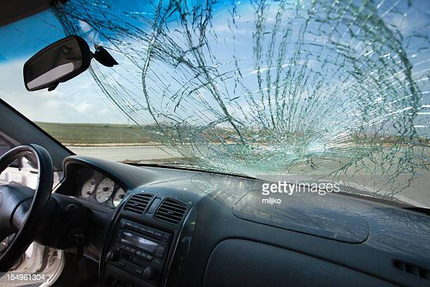 Inside of car with the broken windshield. Road accident