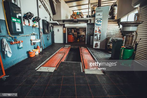 inside of modern auto repair shop - auto repair shop stock pictures, royalty-free photos & images