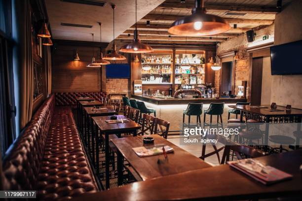 inside of modern city pub - irish culture stock pictures, royalty-free photos & images