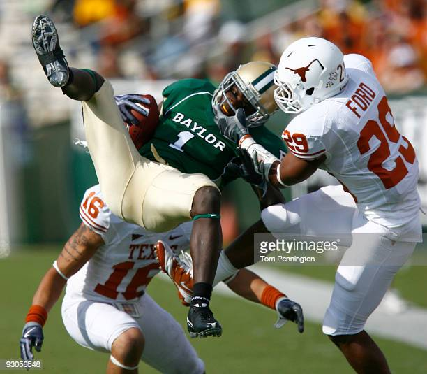 Inside receiver Kendall Wright for the Baylor Bears pull in a pass against defensive back Clark Ford for the Texas Longhorns in the second half on...