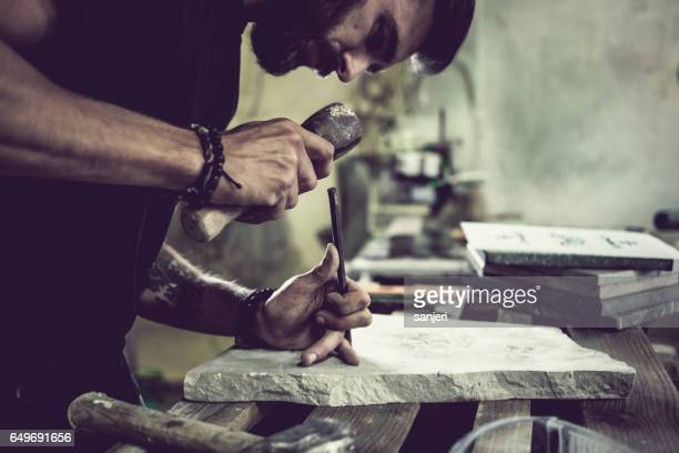inside stonecutter's workshop - sculptor stock pictures, royalty-free photos & images