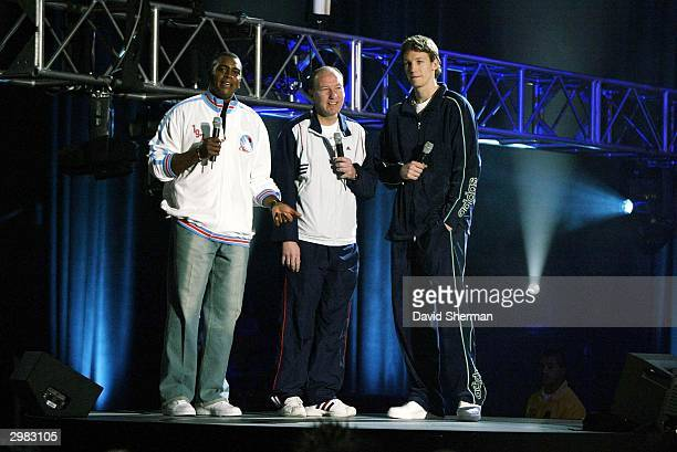 Inside Stuff host Ahmad Rashad with Mike Dunleavy Sr and Mike Dunleavy Jr during the 2004 Read To Achieve Celebration at the Los Angeles Convention...