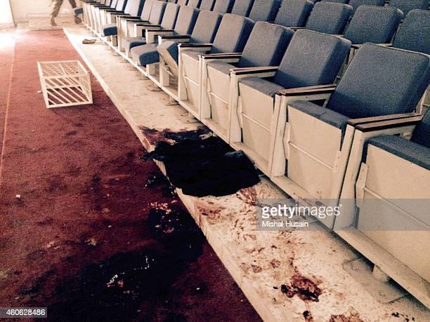 Inside the auditorium of an armyrun public school that was targeted by Taliban militants in a deadly assault that claimed the lives of 141 students...