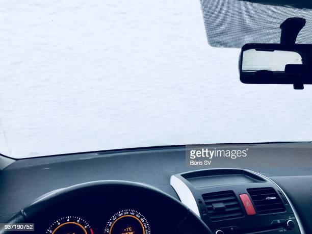 Inside the car covered by snow