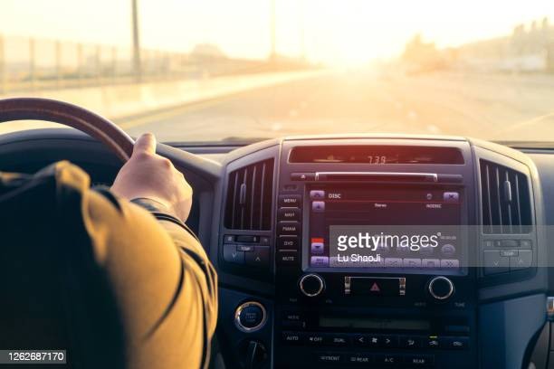 inside the car, driving on the highway at sunset in dubai uae. - radio stock pictures, royalty-free photos & images