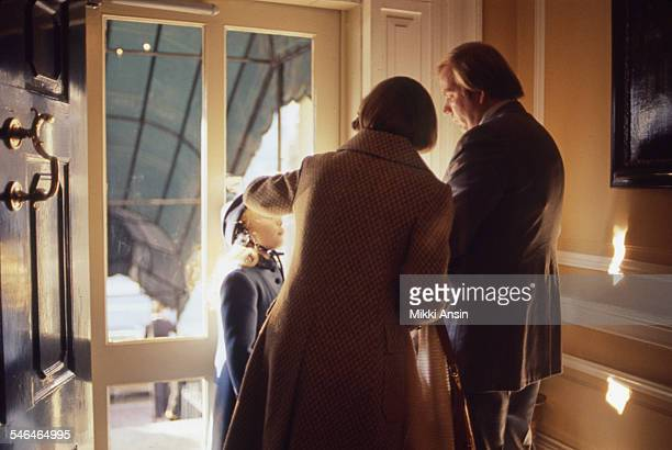Inside the front door of Blair House an unidentified man and woman help Amy Carter daughter of newly inaugurated US President Jimmy Carter prepare...