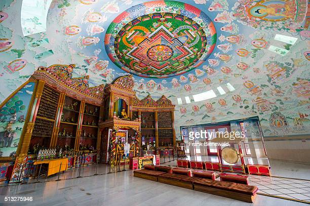 Inside the hall of the Great Drigung Kugyud Lotus Stupa one of the many international Buddhist temples surrounding the birthplace of Siddhartha...