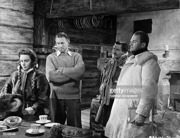 Inside the headman's house during a tense scene in 'The Valley Of Eagles' starring Nadia Gray John McCallum Martin Boddey and Jack Warner Filmed in...