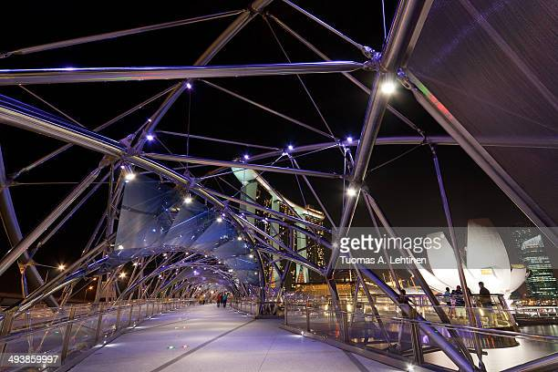 Inside the Helix Bridge in Singapore at dusk