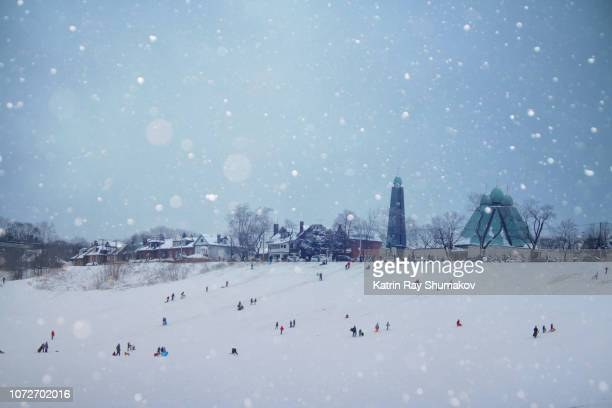 inside the magic snow globe - tobogganing stock pictures, royalty-free photos & images