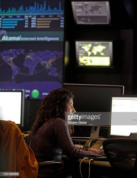 Inside the Network Operations Command Center at Akamai in Cambridge network operations engineer Nicole Fusco is shown at work