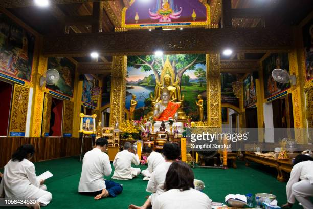 inside the prayer hall of wat sahakon or wat doi nang - religious event stock pictures, royalty-free photos & images