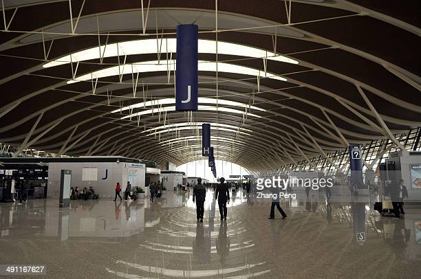 Inside the Pudong International Airport in Shanghai The airport is the world's third busiest airport by cargo traffic and the busiest international...