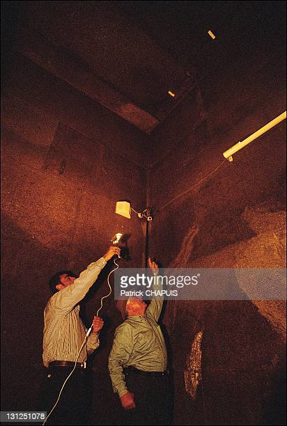 Inside the pyramid of Kheops Dr Hawass shows ancient fissures in the King's chamber in Giza Egypt in 2005